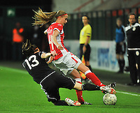 20131009 - LIEGE , BELGIUM : Standard's Julie Biesmans (right) tackled by Glasgow's Suzanne Malone (13) during the female soccer match between STANDARD Femina de Liege and GLASGOW City LFC , in the 1/16 final ( round of 32 ) first leg in the UEFA Women's Champions League 2013 in stade Maurice Dufrasne - Sclessin in Liege. Wednesday 9 October 2013. PHOTO DAVID CATRY