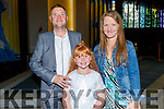 Charlotte Rigney from Holy Family NS with her parents John Rigney and Kerry Lawless at her First Holy communion at St Brendans Church on Saturday.