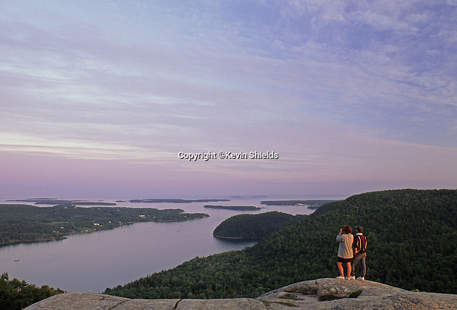 People enjoying the view from Acadia Mountain in Acadia National Park, Maine, USA