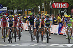 Riders including Matthew Harley Goss and Stuart O'Grady  (AUS) Orica GreenEdge cross the finish line at the end of Stage 3 of the 99th edition of the Tour de France 2012, running 197km from Orchies to Boulogne-sur-Mere, France. 3rd July 2012.<br /> (Photo by Eoin Clarke/NEWSFILE)