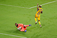 22nd December 2020, Orlando, Florida, USA;  LAFC Kennerth Vermeer saves a shot on goal; from Tigres Luis Quinones  during the Concacaf Championship between LAFC and Tigres UANL on December 22, 2020, at Exploria Stadium in Orlando, FL.
