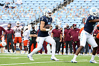 CHAPEL HILL, NC - OCTOBER 10: Sam Howell #7 of North Carolina wastes as much time as possible before kneeling down while trying to run out the clock during a game between Virginia Tech and North Carolina at Kenan Memorial Stadium on October 10, 2020 in Chapel Hill, North Carolina.