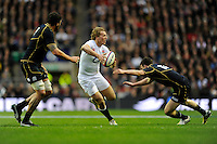 Billy Twelvetrees of England is tackled by Jim Hamilton (left) and Matt Scott of Scotland during the RBS 6 Nations match between England and Scotland at Twickenham on Saturday 02 February 2013 (Photo by Rob Munro)