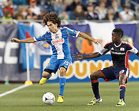 Philadelphia Union midfielder Gabriel Farfan (15) attempts to control the ball as New England Revolution midfielder Clyde Simms (19) closes. In a Major League Soccer (MLS) match, the New England Revolution tied Philadelphia Union, 0-0, at Gillette Stadium on September 1, 2012.