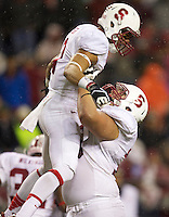 SEATTLE, WA - September 28, 2013: Stanford wide receiver Michael Rector, left, celebrates a touchdown with teammate guard Kevin Danser Stanford against Washington State at CenturyLink Field. Stanford won 55-17