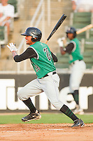 Ydwin Villegas #28 of the Augusta GreenJackets follows through on his swing against the Kannapolis Intimidators at Fieldcrest Cannon Stadium June 24, 2010, in Kannapolis, North Carolina.  Photo by Brian Westerholt / Four Seam Images