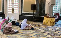 Imam Leading Women in a Quranic Study Meeting, Ubudiah Mosque, Kuala Kangsar, Malaysia.