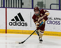 WORCESTER, MA - JANUARY 16: Cayla Barnes #23 of Boston College passes the puck during a game between Boston College and Holy Cross at Hart Center Rink on January 16, 2021 in Worcester, Massachusetts.