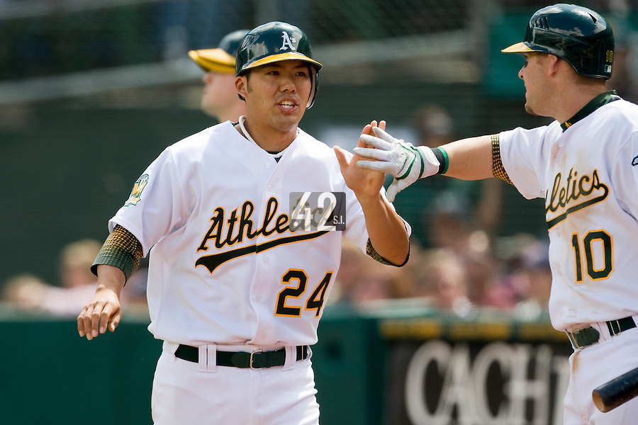 6 April 2008: A's #24 Kurt Suzuki is congratulated by A's #10 Daric Barton after scoring a run during the Cleveland Indians 2-1 victory over the Oakland Athletics at the McAfee Coliseum in Oakland, CA.
