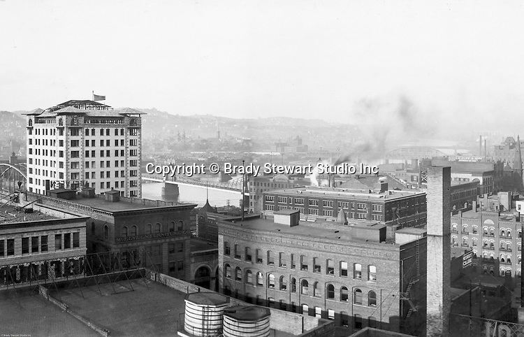 Pittsburgh PA: View of City from the top of the Empire Building. View of the city looking across to the Allegheny River and North Side. The Bessemer Building in the left near the river.