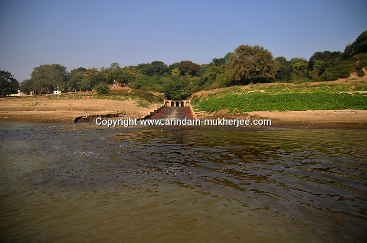 Black sewage water entering the river Ganga at Varanasi, Uttar Pradesh, India.