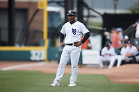 Lazaro Leal (30) of the Winston-Salem Dash coaches first base during the game against the Greensboro Grasshoppers at Truist Stadium on June 19, 2021 in Winston-Salem, North Carolina. (Brian Westerholt/Four Seam Images)