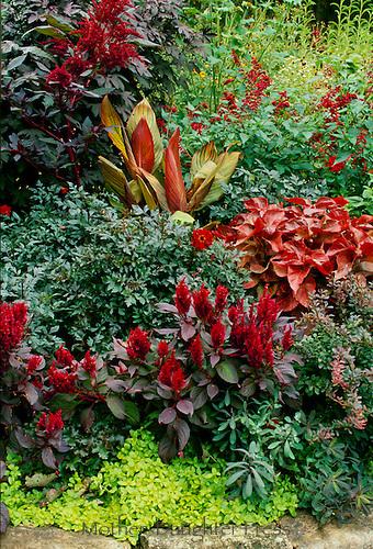 Red garden design with rock border, Missouri USA