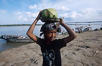 CAMBODIA Mekong River, boy selling coconut / KAMBODSCHA Mekong Fluss, Junge verkauft Kokosnuss