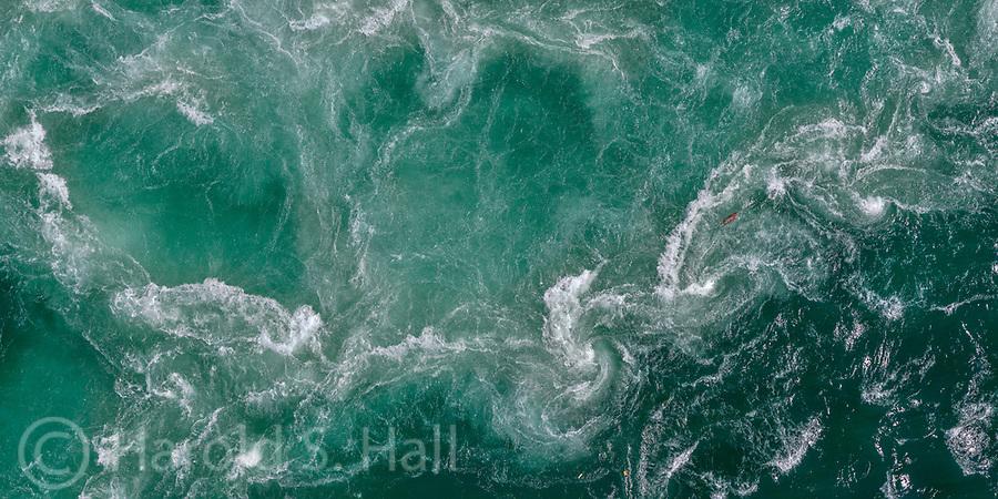An aerial tram ride near Niagara Falls provides a birds-eye view of the turbulent waters below.