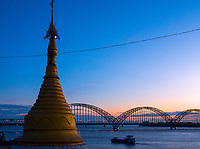A stupa and the Bridge over the Irrawaddy River and leading to Sagaing at twilight