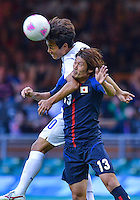 August 10, 2012..Japan's Daisuke Suzuki and South Korea's Park Chu-young in action during bronze medal match at the Millennium Stadium on day fourteen in Cardiff, England. Korea defeat Japan 2-0 to win Olympic bronze medal in men's soccer. ..