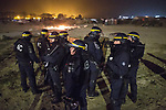 "© Joel Goodman - 07973 332324 . 23/10/2016 . Calais , France . Riot police at the Calais migrant camp known as "" The Jungle "" , in Northern France , on the evening before the start of the eviction and destruction of the camp . Photo credit : Joel Goodman"