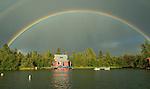 Houseboat under rainbow