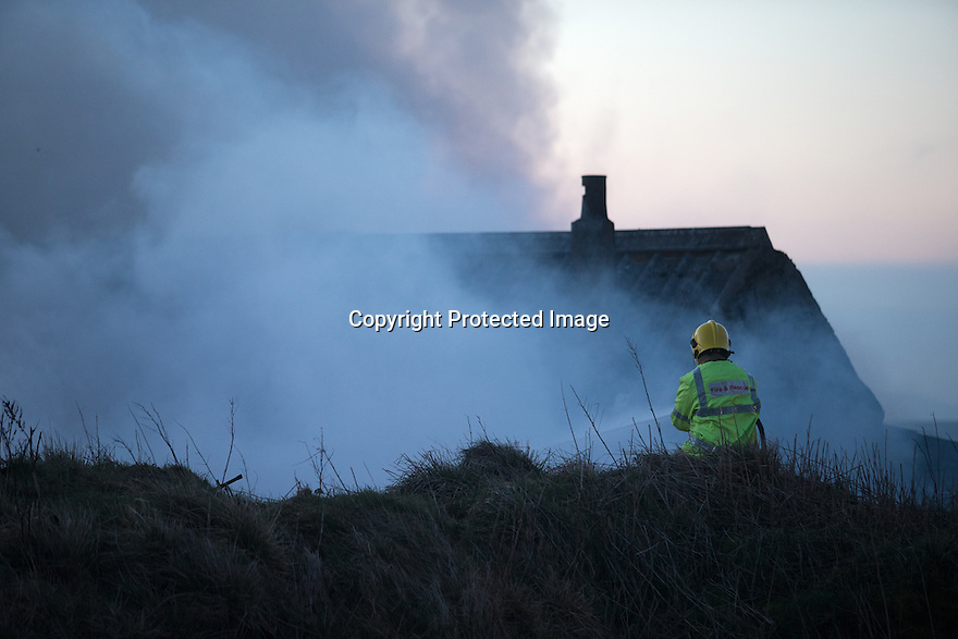 """31/03/16<br /> <br /> Four children had a lucky escape this morning, after a shed caught fire and spread to nearby barns on a farm near Britain's highest village in Staffordshire.<br /> The youngsters were treated from smoke inhalation after an early-morning blaze at Summerhill Farm, in Flash, a remote village on the Staffordshire Moorlands.<br /> Three fire crews from Staffordshire, plus one from Derbyshire, were called to the incident, which was reported at around 5.42am.<br /> A spokeswoman for Staffordshire Fire and Rescue Service said the barns were """"well ablaze"""" and that a water carrier was also sent to help.<br />  She said: """"The fire involved a shed which was attached to a brick building and crews worked to prevent it spreading further into the residential area. <br /> """"A caravan was also on fire.""""<br /> <br /> All Rights Reserved: F Stop Press Ltd. +44(0)1335 418365   www.fstoppress.com."""