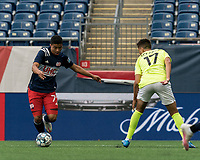FOXBOROUGH, MA - MAY 12: Damian Rivera #72 of New England Revolution II dribbles as John Scearce #17 of Union Omaha defends during a game between Union Omaha and New England Revolution II at Gillette Stadium on May 12, 2021 in Foxborough, Massachusetts.