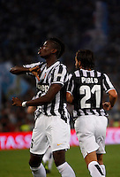 Calcio, Supercoppa di Lega: Juventus vs Lazio. Roma, stadio Olimpico, 18 agosto 2013.<br /> Juventus midfielder Paul Pogba, of France, celebrates past teammate Andrea Pirlo, right, after scoring during the Italian League Supercup football final match between Juventus and Lazio, at Rome's Olympic stadium,  18 August 2013.<br /> UPDATE IMAGES PRESS/Isabella Bonotto