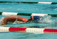 Competitive swimmer in lane.
