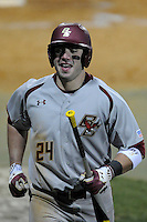 Right fielder Chris Shaw (24) of the Boston College Eagles crosses the plate after scoring a run in a game against the Wofford College Terriers on Friday, February 13, 2015, at Russell C. King Field in Spartanburg, South Carolina. Wofford won, 8-4. (Tom Priddy/Four Seam Images)