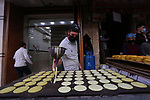A Palestinian vendor prepares ''Qatayef'', traditional pancakes that are popular on Muslim holy month of Ramadan, in Khan Younis in the southern Gaza Strip on on April 22, 2021 amid the coronavirus disease (COVID-19) outbreak. Palestinians welcomed the Muslim fasting month of Ramadan under the shadow of economic difficulties caused by the Israeli blockade and the coronavirus pandemic. Nineteen people have died of the coronavirus disease in Palestine in the last 24 hours and 1652 new cases were recorded, according to the daily report on the disease. Health Minister Mai Alkaila said 11 of the dead and 1179 of the new cases were in the Gaza Strip. Photo by Ashraf Amra