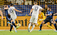 CARSON, CA - SEPTEMBER 21: Uriel Antuna #18 of the Los Angeles Galaxy takes a shot past Evan Bush #1 of the Montreal Impact during a game between Montreal Impact and Los Angeles Galaxy at Dignity Health Sports Park on September 21, 2019 in Carson, California.