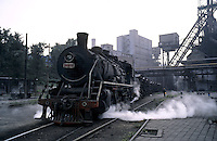 A steam train in Benxi Iron and Steel Group in Liaoning. China's second-largest steelmaker Anshan Iron & Steel Group has merged with smaller rival Benxi Steel Group to create a company with capacity that will match the mainland's biggest steelmaker, Shanghai Baosteel Group..01 Sep 2005