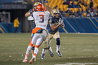 Pitt wide receiver Tyler Boyd (23) makes a 49-yard touchdown catch on a swing pass. Syracuse safety Durell Eskridge (3) is blocked by Pitt lineman Matt Rotheram.  The Pitt Panthers defeated the Syracuse Orange 30-7 at Heinz Field, Pittsburgh, Pennsylvania on November 22, 2014.
