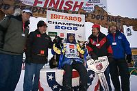 Robert Sorlie w/Lead Dogs 1st Place Under Banner @ Finish Line Iditarod 2005