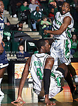 North Texas Mean Green forward George Odufuwa (4) takes a fall as North Texas Mean Green guard Dominique Johnson (1) watches in the NCAA  basketball game between the Florida International University Panthers and the University of North Texas Mean Green at the North Texas Coliseum,the Super Pit, in Denton, Texas. UNT defeated FIU 87 to 77