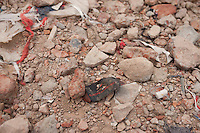 A clothes tag lies in the rubble of a garments factory that collapsed in Savar, near Dhaka, Bangladesh