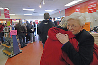 B. Dalton bookstore manager Nancy Kenish gets a hug from one of her longtime customers on the final day of sales at the Westerville, Ohio, suburban strip center bookstore. The store, one of the smallest in the chain, was closing after nearly two decades tucked in the corner of a building housing an insurance company and a balloon store.(Gary Gardiner/EyePush Newsphotos)<br />