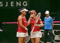 The Netherlands, Den Bosch, 20.04.2014. Fed Cup Netherlands-Japan, Ozaki/Aoyama<br /> Photo:Tennisimages/Henk Koster