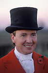 Master of the Foxhounds MFH wearing top hat and red hunting coat. Fox hunting Belvoir Hunt Leicestershire 1980s UK.