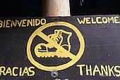 Osa Peninsula, Costa Rica. Marenco ecotourist lodge; 'Remove Your Boots' sign.
