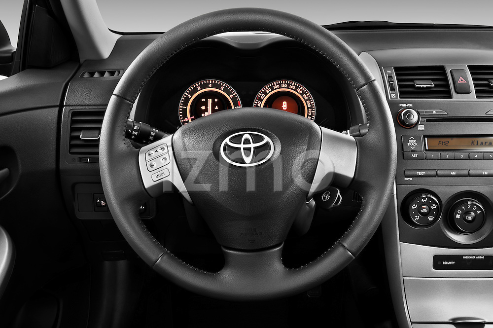Steering wheel view of a 2010 Toyota Corolla Linea Sol 4 Door Sedan