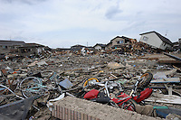Mangled remain in town of Natori, after the earthquake and tsunami knocked out all mobile communications lines.  The Tsunami devastated ahe entire pacifc coastline of Japan after the earthquake and tsunami devastated the area Sendai, Japan.<br />