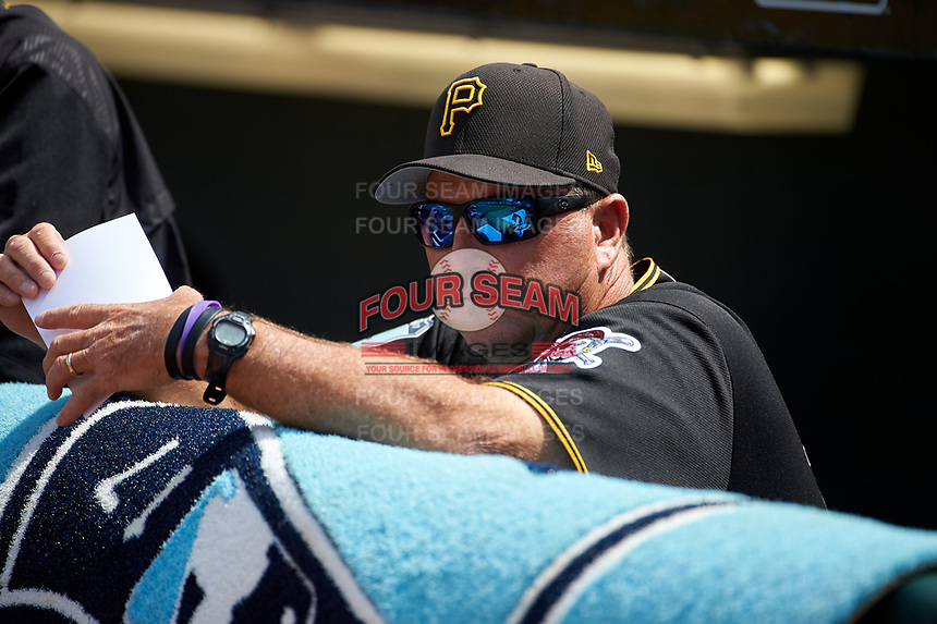 Pittsburgh Pirates coach Tom Prince (14) in the dugout before a Grapefruit League Spring Training game against the New York Yankees on March 6, 2017 at LECOM Park in Bradenton, Florida.  Pittsburgh defeated New York 13-1.  (Mike Janes/Four Seam Images)