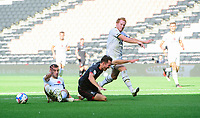 Lincoln City's Tom Hopper is fouled by Milton Keynes Dons' Baily Cargill, left, to win a penalty<br /> <br /> Photographer Chris Vaughan/CameraSport<br /> <br /> The EFL Sky Bet League One - Milton Keynes Dons v Lincoln City - Saturday 19th September 2020 - Stadium MK - Milton Keynes<br /> <br /> World Copyright © 2020 CameraSport. All rights reserved. 43 Linden Ave. Countesthorpe. Leicester. England. LE8 5PG - Tel: +44 (0) 116 277 4147 - admin@camerasport.com - www.camerasport.com