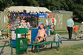 A young man waits for tourist customers at a kiosk outside the Wawel Castle in Krakow.