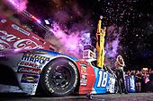 #18: Kyle Busch, Joe Gibbs Racing, Toyota Camry M&M's Red White & Blue, celebrates after winning.