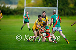 Mark Topey of Tuosist been well marked by Conor Keane and Owen Tydings of Asdee as his team mate Peter O'Shea looks on, in the Novice football championship semi final