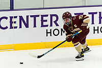 WORCESTER, MA - JANUARY 16: Cayla Barnes #23 of Boston College brings the puck forward during a game between Boston College and Holy Cross at Hart Center Rink on January 16, 2021 in Worcester, Massachusetts.