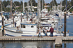Fishermen talk in the marina at Charleston Harbor, near Coos Bay, Oregon, a Pacific Ocean fishing port.  Charleston Harbor is often said to be the most picturesque of the Oregon fishing fleets.