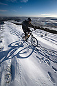 21/11/15<br /> <br /> Mountain bikers brave freezing condition to ride through stunning scenery urrounded by dazzling sunshine and blue skies after overnight snow fall on Rushup Edge in the Derbyshire Peak District near Castleton.<br /> <br /> All Rights Reserved: F Stop Press Ltd. +44(0)1335 418365   +44 (0)7765 242650 www.fstoppress.com