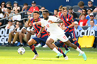 KANSAS CITY, KS - JULY 18: Cyle Larin #17 of Canada ,Miles Robinson #12 of the United States during a game between Canada and USMNT at Children's Mercy Park on July 18, 2021 in Kansas City, Kansas.